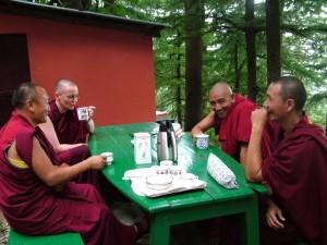 Meanwhile outside. A rare shot of the amazing & tireless attendants Gen Zamling, Gen Sangpo and Gen Tenzin Gyaltsen with translator Geshe Kelsang Wangmo.