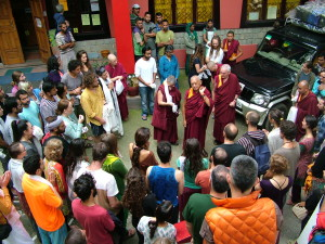 Lama Zopa Rinpoche before His departure – taking every opportunity to give blessings, presents and to teach.