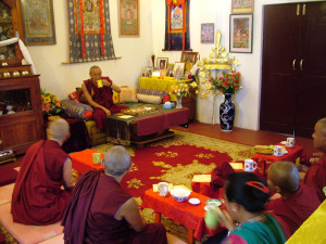 Meanwhile Khen Rinpoche Geshe Chonyi and other visitors are enjoying some tea in Lama Yeshe's Room.
