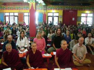 A packed gompa with 120 students from two courses and many visitors filling the aisles.